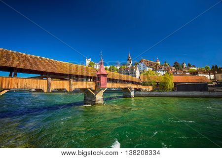 Lucerne, Switzerland - May 8, 2016 - Spreuer Bridge In The Old City Center Of Luzern With The Hotel