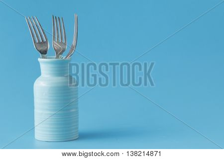 lot of Stainless fork on blue table