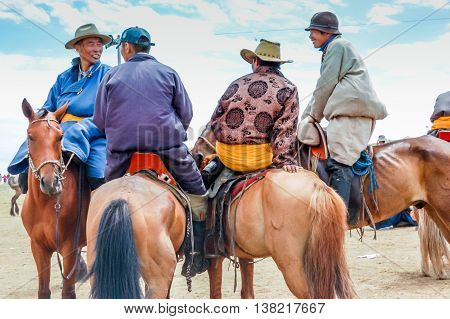 Khui Doloon Khudag Mongolia - July 12 2010: Horseback locals at Nadaam (Mongolia's most important festival whose roots lie in Mongolian warrior traditions) horse race near capital Ulaanbaatar.