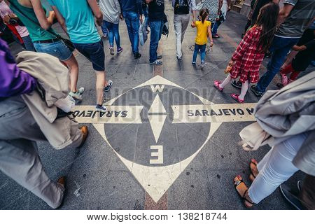 Sarajevo Bosnia and Herzegovina - August 23 2015. People walks next to West and East Meeting of Cultures sign at Ferhadija Street