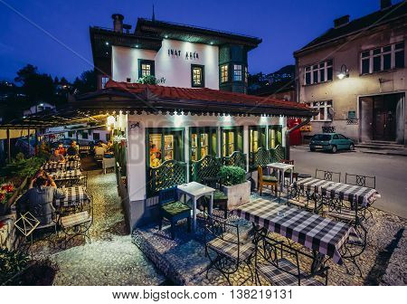 Sarajevo Bosnia and Herzegovina - August 24 2015. Evening view of famous Inat kuca (House of Spite) restaurant in Sarajevo