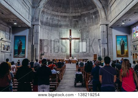 Mostar Bosnia and Herzegovina - August 25 2015. People takes part in the Mass in St Peter and Paul Franciscan Church