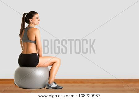 Woman Sitting On A Yoga Ball