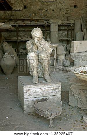 POMPEII - 15 AUGUST 2013: Statue in ruins of Pompeii. ITALY.