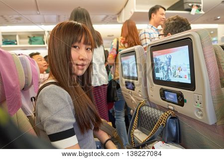HONG KONG - MAY 12, 2016: Woman onboard Emirates A380. The Airbus A380 is a double-deck, wide-body, four-engine jet airliner manufactured by Airbus. It is the world's largest passenger airliner.