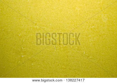 Yellow sponge with green scrubber - isolated