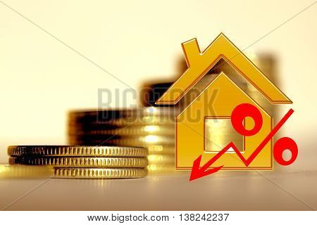 Red icon of interest on the background of coins . The concept of reducing property prices
