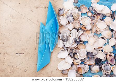 Paper Boat With Shells And Sand. Vocation And Travel Background
