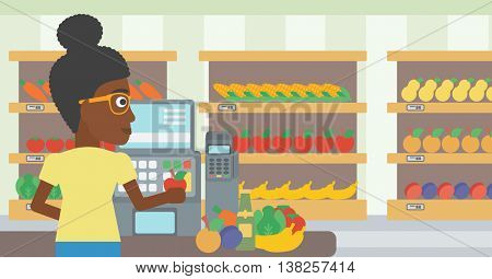 An african-american young female cashier standing at the checkout at the supermarket. Female cashier working at checkout at the supermarket. Vector flat design illustration. Horizontal layout.