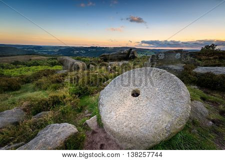 Sunset in the Peak District with millstone