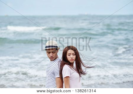 Vietnamese young couple having difficulties in relationship