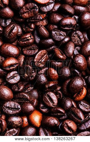 Roasted coffee beans as a background. Coffee bean  macro