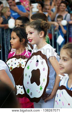 Montenegro, Herceg Novi - 04/06/2016: Cirls in fancy dress donuts. 10 International Children's Carnival