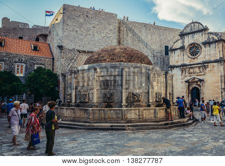 Dubrovnik Croatia - August 26 2015. Tourists walks next to Great Onofrio's Fountain at Stradun street