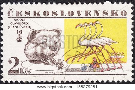 MOSCOW RUSSIA - JANUARY 2016: a post stamp printed in CZECHOSLOVAKIA shows a Bear and flamingos the series