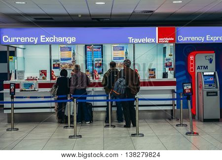 Prague Czech Republic - October 2 2015. People exchanges currency at Vaclav Havel Airport Prague