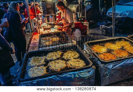 Pilsen Czech Republic - October 3 2015. Man sells potato pancakes during Pilsen Fest in Pilsen (Plzen) city