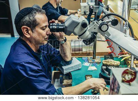 Jerusalem Israel - October 18 2015. Man works in Yvel Jewelry Factory in Jerusalem