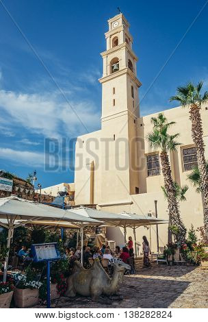 Tel Aviv Israel - October 20 2015. People sits in restaurant in front of St. Peter's Church located in Jaffa old town area