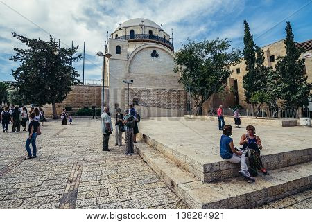 Jerusalem Israel - October 22 2015. Tourists and local residents on the square in front of The Ruin Synagogue (Hurva Synagogue) located in the Jewish Quarter