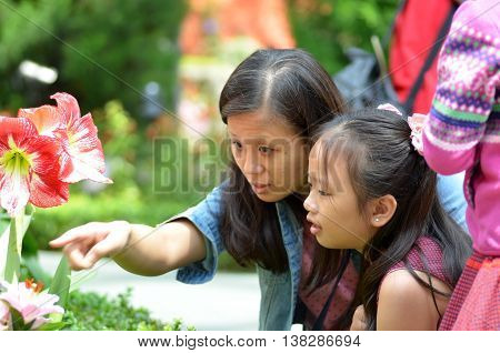 SINGAPORE- 10 JULY 2016: Mother and daugther enjoy the beauty in the Flower Dome Gardens by the Bay