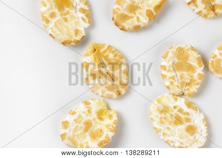 detail of oat flakes on white background
