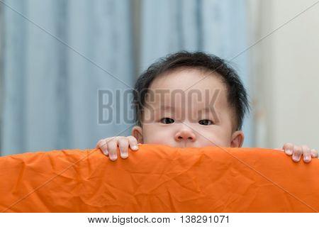 Asian Baby In Playpen