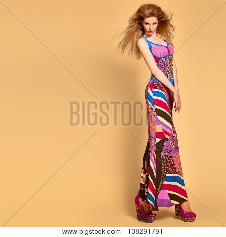 Fashion woman in colorful Summer Outfit, Glamor heels with Fashion hairstyle, Trendy Makeup. Beauty sexy blonde Model, Stylish summer look. Playful model girl, long legs. Unusual creative