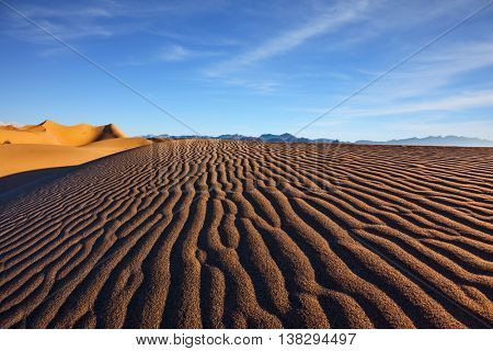 Mesquite Flat Sand Dunes. Bright sunny morning in a picturesque part of Death Valley, USA. Sand dunes are covered with small ripples