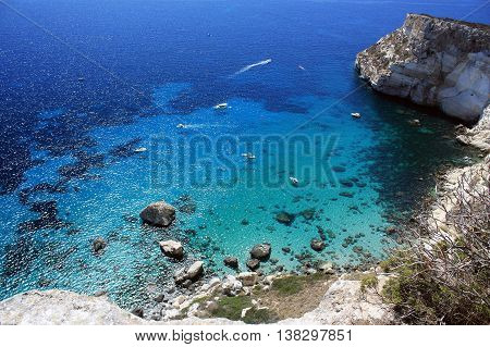 View from above on the sea with transparent water and sea floor. Location La Sella del Diavolo - The Devil's Saddle in Cagliari Sardinia, Italy.