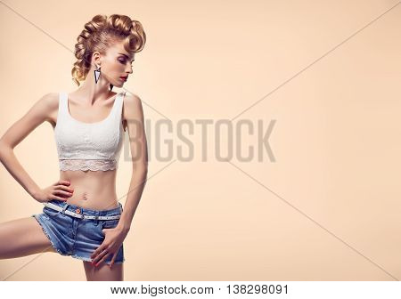 Fashion. Hipster woman in Stylish Summer fashion Outfit. Playful crazy girl cheeky emotions. Blond sexy Model, Trendy Glamour Fashion clothes posing. Unusual Creative mohawk. Stylish fashion hairstyle