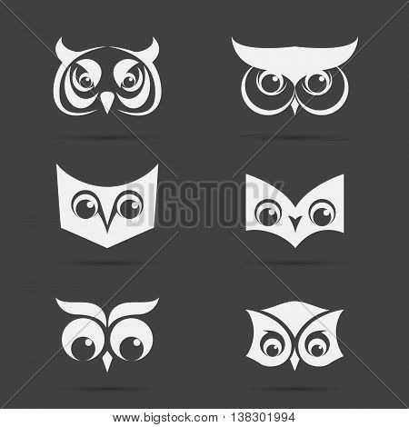 Vector image of an owl face design on black background. Vector owl face for your design.