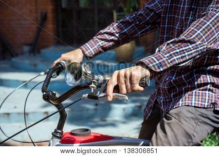 Man On Bicycle Presses On Brake