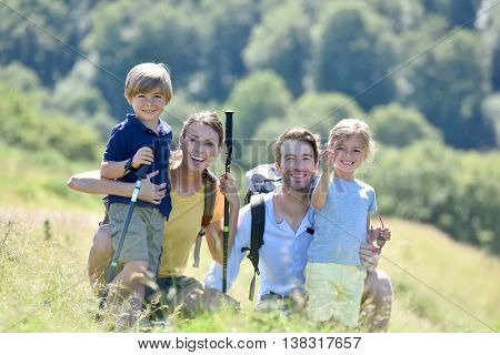 Portrait of happy family on a hiking day in the mountain