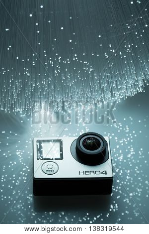 Pecs, Hungary - July 10, 2016: GoPro Hero 4 on fiber optical background. It is a compact, lightweight personal camera manufactured by GoPro Inc.