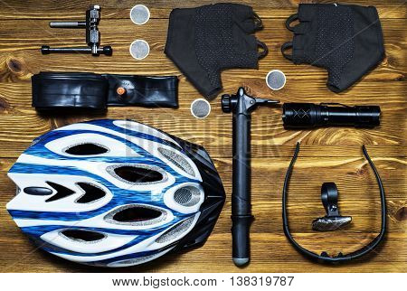 Items replacements and tools for a safe cycling: Helmet gloves glasses pumps patches tire chain tool. Tools and accessories set for cycling, flat lay