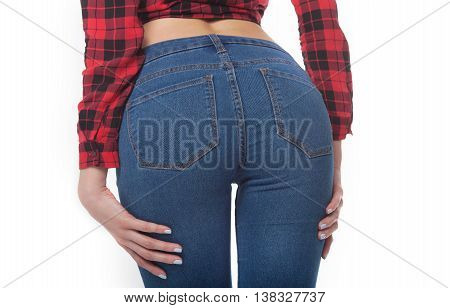 Fit female butt in blue jeans, isolated on white. Slim body. Pretty sexy woman model with amazing body. Hot buttocks.