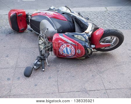 BERLIN GERMANY - JULY 6 2016: Failure: Bayern Munich motorcycle fallen down