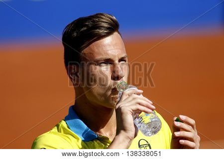 BARCELONA - APRIL,19: Hungarian tennis player Marton Fucsovics in action during a match of Barcelona tennis tournament Conde de Godo on April 19, 2016 in Barcelona