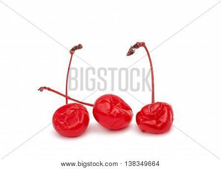 Maraschino cherries red, stems on white background