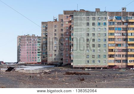 Multi-storey residential building in Norilsk. House on pile foundation, built on permafrost.