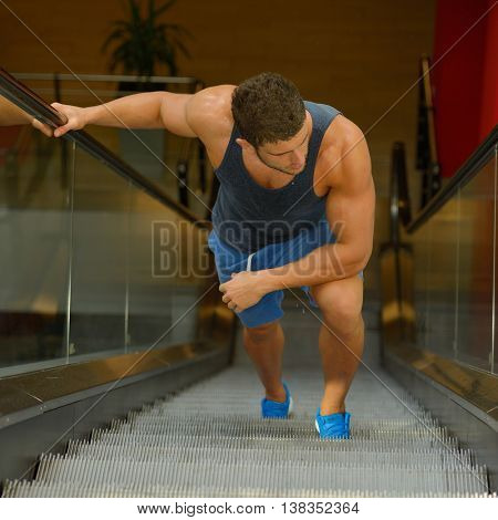 young man exercising in the gym on the stairs