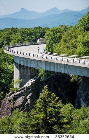 Cyclist on the Linn Cove Viaduct in Summer on a quiet summer day
