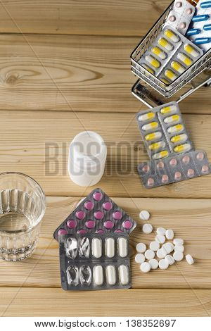 Shopping cart with different tablets and various pill blister packs