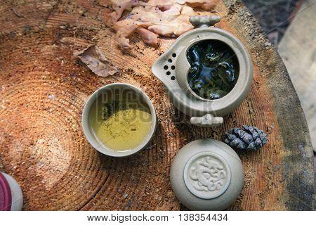 Tea Set Outdoors On A Wooden Stump