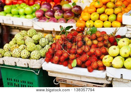 Asian Farmer Market Selling Passion Fruit And Cherimoya And Other