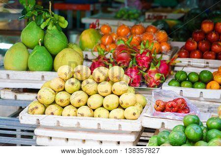 Asian Farmer Market Selling Mango And Dragon Fruit In Vietnam