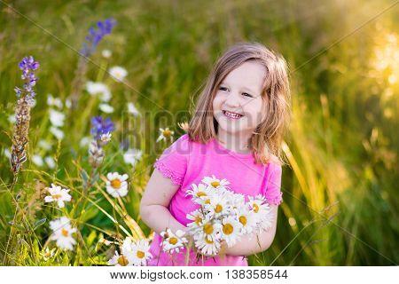 Little Girl In Daisy Flower Field