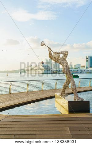 Sculpture Of Jazz Player And Singapore Cruise Center At Harborfront