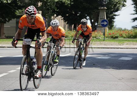 CUNEO, ITALY - JULY 10, 2016: a group of cyclists arrive to the finish of Fausto Coppi road cycling race. Cuneo, Italy, Europe.